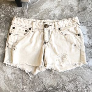 Free People mid rise distressed white jean shorts